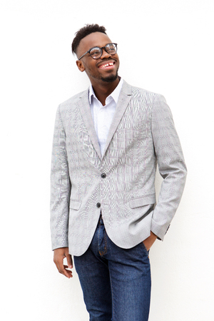 Portrait of young black businessman with glasses against white background