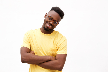 Portrait of smiling african american man with glasses against white background