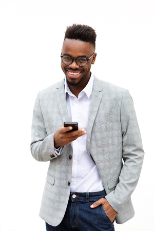 Portrait of african american businessman with cell phone against white background Standard-Bild