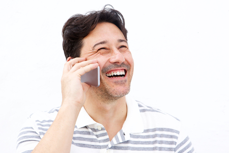 Close up portrait of man talking on mobile phone and laughing