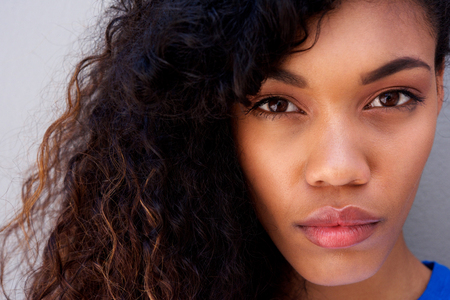 Close up portrait of beautiful young african american woman staring Stock Photo - 95038556