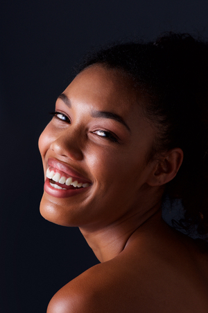 Close up portrait of black beauty woman against dark background