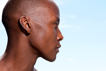 Close up profile portrait of handsome african american man staring