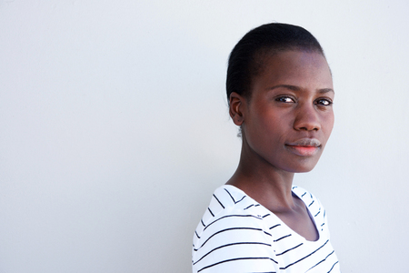 Close up portrait of attractive young black woman with serious expression