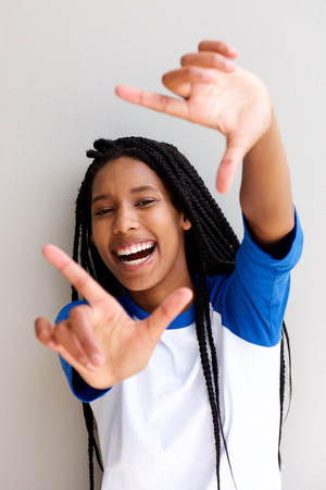Close up portrait of happy african american girl making frame with fingers Stock Photo