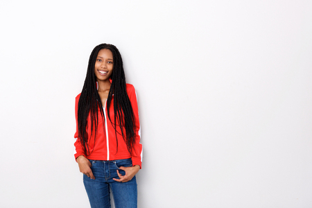 Portrait of attractive young woman in red jacket posing on white background