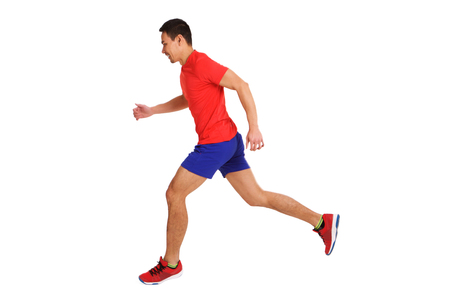 Full length side portrait of fit older asian man running over white background