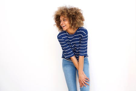 cheerful young black woman smiling against white background