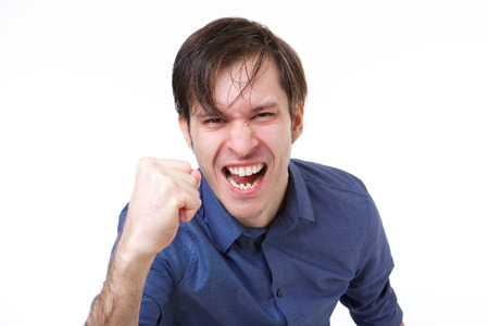 Close up portrait of man shaking fist in emotional gesture