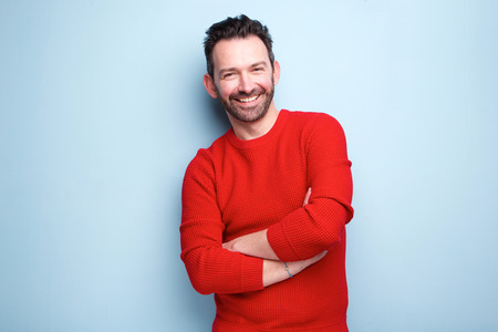Portrait of cheerful man with beard posing against blue background Reklamní fotografie