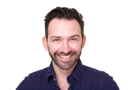 Close up portrait of smiling man with beard against white background