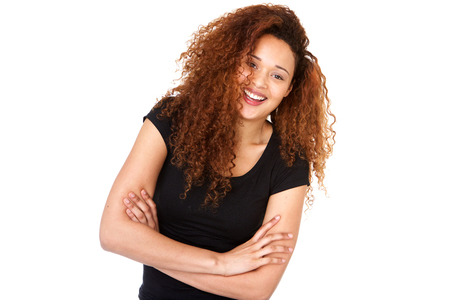 Horizontal portrait of happy young woman smiling with arms crossed against isolated whit background Stock fotó