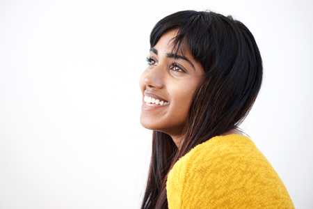 Close up side portrait of cheerful young Indian woman against isolated white background Stock Photo - 108667578