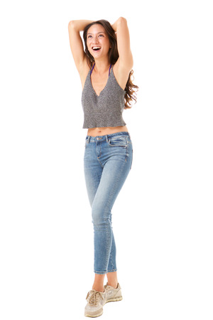 Full body portrait of young asian woman laughing with hands behind head against isolated white background Stock Photo
