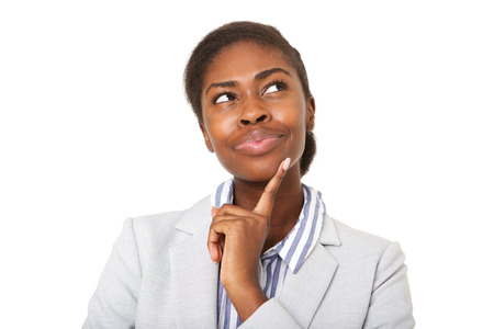 Close up portrait of attractive young black woman thinking and looking up