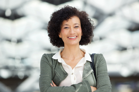 Close up portrait of attractive middle age african american woman smiling 免版税图像