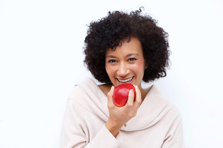 Close up portrait of healthy african american woman eating apple 스톡 콘텐츠