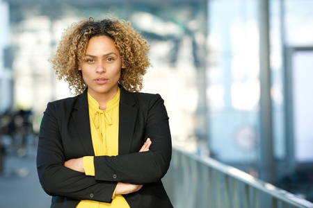 Close up portrait of businesswoman with arms crossed Stok Fotoğraf