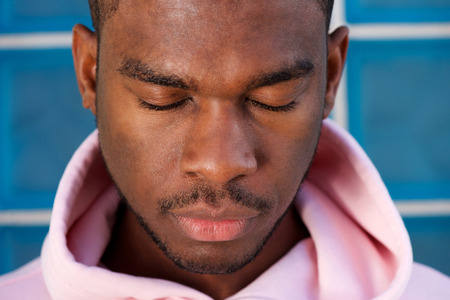 Close up portrait of young african american man with eyes closed Banco de Imagens