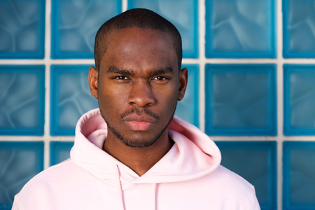 Close up portrait of cool young black man staring