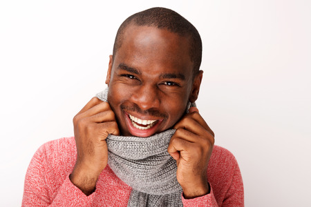 Close up horizontal portrait of happy young black ma n with scarf against white background Banco de Imagens