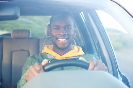 Portrait of happy african american man driving car Stockfoto