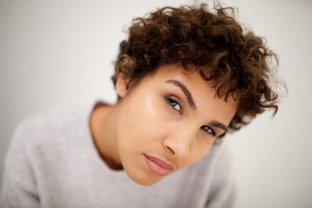 Close up portrait of attractive young woman staring