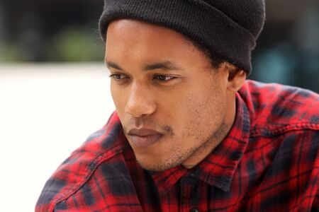 Close up portrait of handsome african american male fashion model looking away
