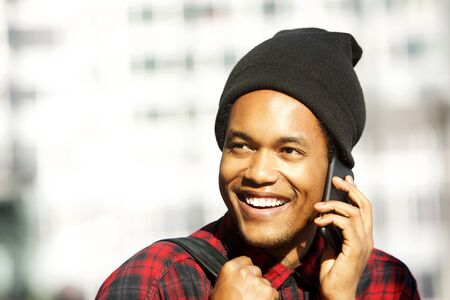Close up portrait of smiling african american man talking with cellphone Stok Fotoğraf