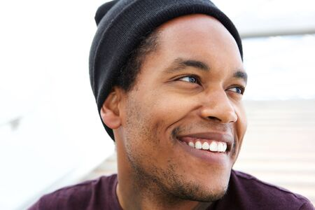 Close up candid portrait of happy handsome african american man Stok Fotoğraf