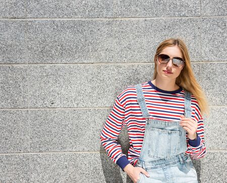 Portrait of cool blond teenage girl with sunglasses Stock fotó