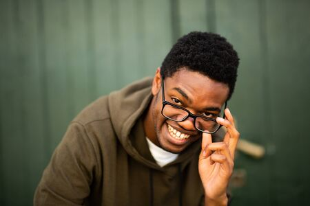 Close up portrait of handsome young african american man with glasses smiling