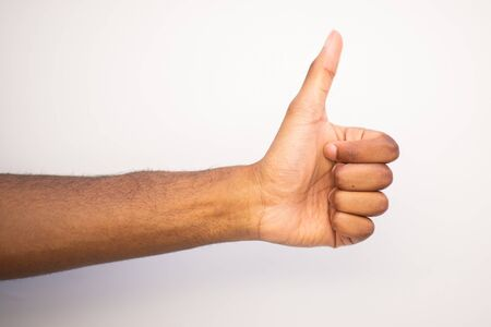 Side angle black man arm with thumbs up hand sign