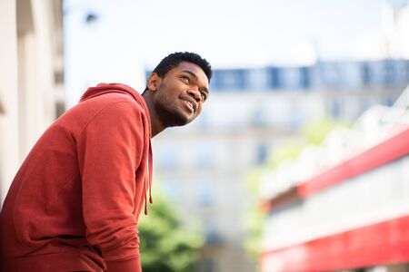 Side portrait of handsome young african american man outside
