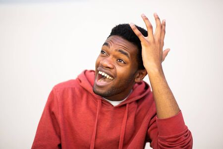 Close up portrait of african american man with surprised expression