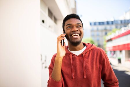 Portrait smiling african american man talking with cellphone outside Stockfoto
