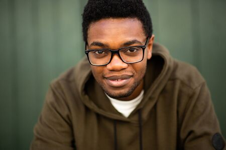 Close up portrait of handsome young african american man with glasses staring Stockfoto