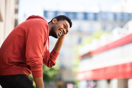 Side portrait of laughing african american man outside