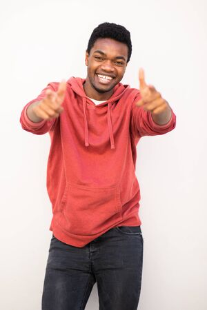Portrait of happy young black man pointing fingers