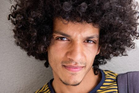 Close up portrait of handsome young North African man with afro hair