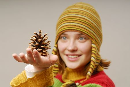 Girl in yellow cap with fir apple  photo
