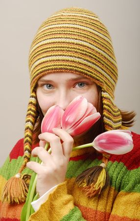 Sight of the girl in yellow cap with tulips photo