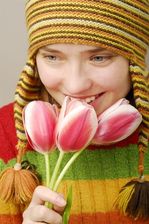 Smiling girl with pink tulips photo