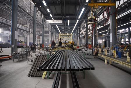 Factory with people and active production photo