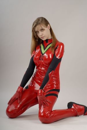 Girl in red costume sits on the floor photo