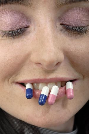 Young womans strange face with pills photo