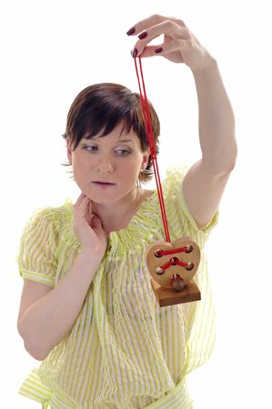 Woman with wooden toy heart in her hands  photo