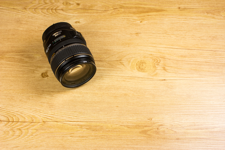 Lens lying on wooden floor Redactioneel