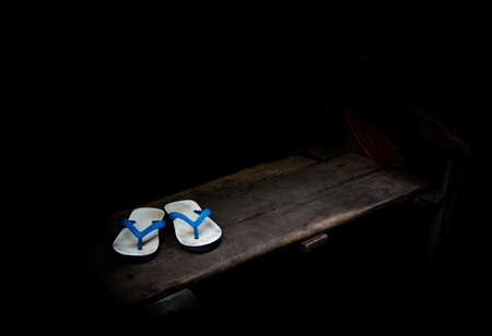 folkways: Old sandals over stairs