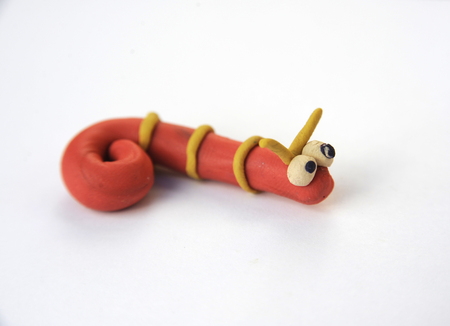 wriggle: Red worm, hand made, plasticine